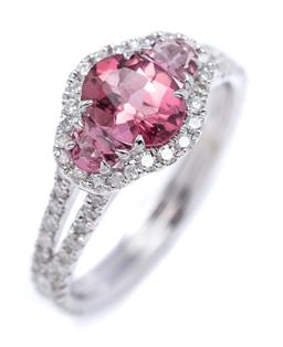 Sale 9194 - Lot 401 - AN 18CT PINK TOURMALINE AND DIAMOND RING; centring an oval cut pink tourmaline flanked by 2 D shape cut tourmalines within a scollap...