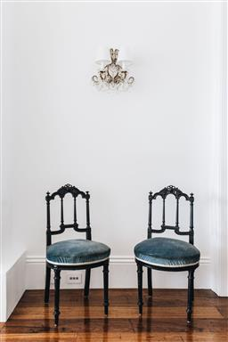 Sale 9200P - Lot 32 - A pair of French black lacquered chairs with blue upholstered seats, Height of back 85cm x Width 46cm x Depth 48cm Provenance; Col...