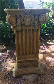 Sale 8284A - Lot 2 - A sandstone finish rectangular pedestal, the top boldly modelled with deeply scrolled corners flanking a goats head above a fluted c...
