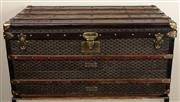 Sale 8871H - Lot 88 - A fine antique Goyard of Paris steamer trunk circa 1910; covered in chevron design canvas with leather trims and brass hardware. Hei...
