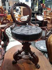 Sale 8925 - Lot 1039 - A victorian swivel piano stool with a carved tripod base and a buttoned leather seat
