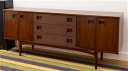 Sale 9239H - Lot 5 - A Mid-Century design rosewood and teak timber sideboard by Grange of London, with with three drawers and four doors, raised on four...