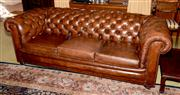 Sale 8015A - Lot 9 - A brown leather three seater Chesterfield