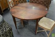 Sale 8499 - Lot 1635 - Round Teak Extension Dining Table