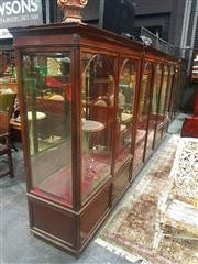 Sale 8693 - Lot 1002 - Late 19th/ Early 20th Century Large Shop Display Cabinet, having six arched panel doors, with some glass shelves, the outside cabine...