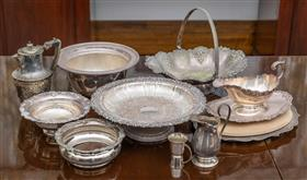 Sale 9195H - Lot 63 - A group of EPNS serving wares including Hardy Brothers baskets, tazza, bottle coasters, sauce boats and jugs