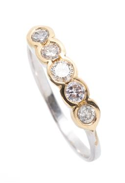 Sale 9253J - Lot 421 - AN 18CT TWO TONE GOLD DIAMOND HALF HOOP RING; part bezel set across the top with 5 round brilliant cut diamonds totalling approx. 0....