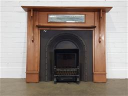 Sale 9255 - Lot 1359 - Timber fire surround with cast iron insert and electric fire (h:122 x w144 x d:22cm)