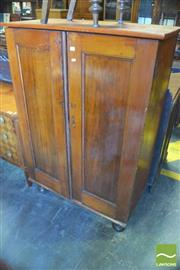 Sale 8390 - Lot 1076 - Early 20th Century Pine Linen Press, with two panel doors, enclosing shelves & turned feet