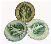 Sale 8828B - Lot 23 - A set of 3 antique French majolica asparagus plates. One with hairline to rim. Diameter 24 cm