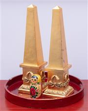 Sale 8891H - Lot 37 - A pair of gilt timber decorative obelisks, together with a lacquered tray and a small babushka doll. Height of obelisks 38cm