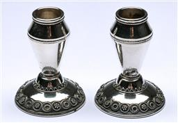 Sale 9164 - Lot 249 - A pair of small sterling silver candle sticks with filigree bases H5cm