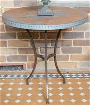Sale 8530A - Lot 339 - An Industrial style outdoor table, the round metal top with nailed edge supported over metal base
