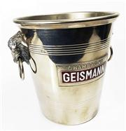 Sale 8828B - Lot 24 - An Art Deco chrome metal champagne bucket by Geismann.  Height 20cm