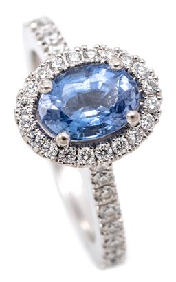 Sale 9132 - Lot 448 - A GREGORY 18CT WHITE GOLD SAPPHIRE AND DIAMOND CLUSTER RING; centring an oval cut blue Ceylon sapphire to surround of 38 round brill...