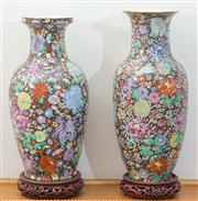Sale 8515A - Lot 16 - A near pair of Chinese baluster vases profusely decorated with colourful enamels in florals on timber bases, taller H 41cm