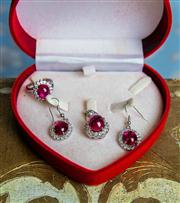 Sale 8577 - Lot 75 - A silvertone diamante crystal and ruby coloured glass costume jewellery set comprising of ring, earrings and pendant (no chain) in h...