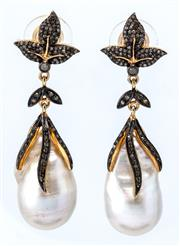 Sale 9029 - Lot 400 - A PAIR OF SILVER GILT DIAMOND AND PEARL DROP EARRINGS; each an approx. 28 x 15mm cultured baroque pearl on a leaf motif surmount stu...