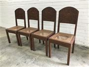 Sale 9068 - Lot 1008 - Set of Four Balinese Heavily Carved Possibly Teak Chairs, the backs with puppet style figures on arabesque ground, caned seats & squ...