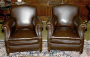 Sale 8015A - Lot 32 - A pair of brown leather armchairs with studded detail