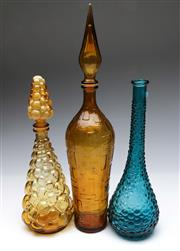Sale 9090 - Lot 36 - Group of three coloured glass genie bottles (one without stopper) (tallest H56cm)