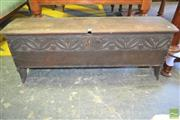 Sale 8255 - Lot 1094 - 17th Century Carved Oak Plank Trunk, the top with later carving, above an original arcade with tulips & chip carved edges