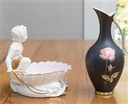 Sale 8470H - Lot 189 - A KPM black handled vase with rose design, H 23cm, together with a French white porcelain dish of a putti in a shell riding two dolp...