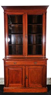 Sale 9020H - Lot 44 - A late 19th century walnut bookcase, the two glazed doors concealing three adjustable shelves, over two drawers and two panel doors,...
