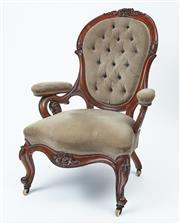 Sale 9080J - Lot 38 - An antique English walnut armchair C: 1870. The back with a floral and scrolling leaf carved head rail and upholstered in deep diamo...