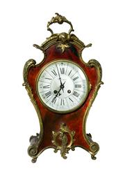Sale 8828A - Lot 43 - Large antique French ormolu mounted red faux shell Mantel clock, 8 day French movement striking gong, Keeps time, key and pendulum 43cm