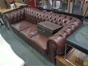 Sale 8648C - Lot 1050 - Brown Leather Button backed Three Seater Chesterfield Lounge