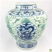 Sale 8649 - Lot 32 - Chinese Dragon Vase in Blue Tones on a Green Background