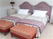 Sale 8677B - Lot 920 - A pair of single beds with gingham upholstered headboards