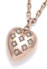 Sale 9012 - Lot 371 - AN ANTIQUE 9CT GOLD PEARL PENDANT NECKACE; 17 x 15mm heart pendant star set with 8 seed pearls on an anchor link chain with barrel c...