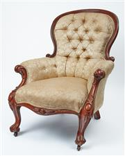 Sale 9080J - Lot 40 - An antique English walnut armchair C: 1865, with scroll carved back and arms, boldly carved knees above knurled legs, the deep butto...