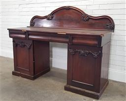 Sale 9188 - Lot 1442 - Early Victorian Mahogany Double Pedestal Sideboard, with carved shaped back, three cushion shaped drawers & two carved panel doors (...