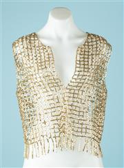 Sale 9027F - Lot 7 - A Lucette beaded bolero jacket in gold, size M