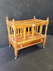 Sale 9048 - Lot 1057 - Early 19th Century Style Canterbury, with slatted dividers, turned corner posts, above a frieze drawer & brass castors (h:53 x w:55cm)
