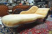 Sale 8282 - Lot 1051 - Late 19th Century Cedar Chaise Longue, with shaped back upholstered in gold buttoned velvet