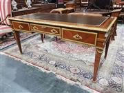 Sale 8693 - Lot 1071 - A Louis XVI Style Parquetry and Ormolu Bureau Plat, with leather top & three drawers on tapering legs (H: 83cm W: 183cm D: 88cm) (ke...