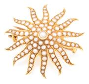 Sale 8915 - Lot 375 - AN ANTIQUE 15CT GOLD STARBURST PEARL BROOCH; set with seed pearls, with Birmingham import hallmarks for 1906, N.H, with hook for ext...