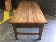 Sale 8976 - Lot 1064 - Rustic Style Oak Refectory Dining Table, with bread-board top, frieze drawer to one end & tapering legs with stretchers (H:79 x W:21...