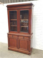Sale 9085 - Lot 1040 - 19th Century French Walnut Bookcase, with oak secondaries, having two glass panel doors, above two drawers & two panel doors - key i...