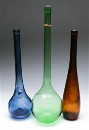 Sale 9090 - Lot 38 - Group of three coloured glass flask bottles (tallest H52cm)