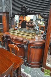 Sale 8282 - Lot 1037 - Victorian Carved Mahogany Serpentine Fronted Sideboard, with mirror back, above a long drawer, four curved panel doors and carved su...