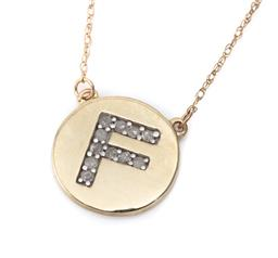 Sale 9132 - Lot 540 - A 10CT GOLD DIAMOND PENDANT NECKLACE; featuring a 12mm disc embossed with the letter F set with 11 single cut diamonds totalling a...