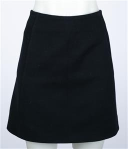 Sale 9095F - Lot 34 - A Balenciaga navy mini Skirt, with zip to back, size 38.
