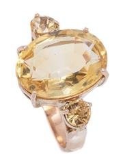 Sale 8999 - Lot 350 - A 9CT GOLD CITRINE COCKTAIL RING; centring an approx. 6.5ct oval cut lemon citrine flanked by 2 round cut lemon citrine on each upsw...