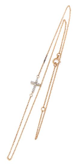 Sale 9132 - Lot 488 - A 10CT GOLD DIAMOND PENDANT NECKLACE; 10 x 7.5mm cross set with 12 single cut diamonds on a gold plated chain.