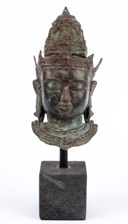 Sale 9150J - Lot 46 - Patinated Bronze Head of Shiva, on stone base - total height 45cm